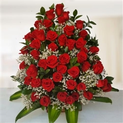 Four dozen red roses in vase