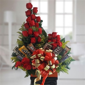 24 red roses in vase with chocolates. Available for Cali and Bogota only.