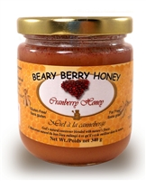 Creamed honey mixed with natural cranberries .