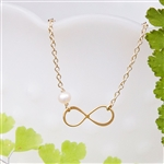 Infinity Necklace in Gold with Single Pearl