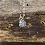 A beautiful little baby footprint charm necklace.