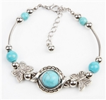Silver butterfly bracelet with blue beads