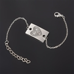 Silver bracelet with peace heart charm