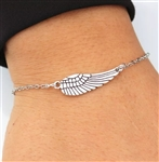 Silver bracelet with wing charm