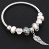 Silver bracelet with pearl beads and wing charm