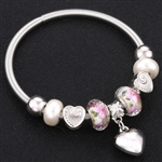 Silver bracelet with pearl beads and heart charm