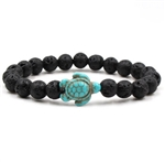 Black beaded stretch bracelet with teal turtle