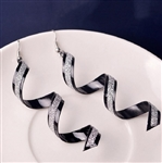Black swirl earrings with silver glitter