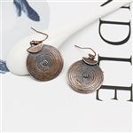 Round copper earrings with blue detail