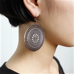 Large round copper patterned earrings