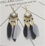 Long gold earrings with black and gray feathers and beads