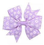 Purple hair bow with white flowers