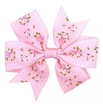 Pink hair bow with white flowers
