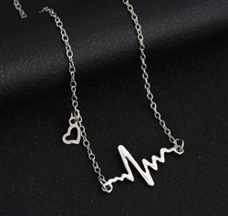 Silver heartbeat pendant necklace