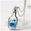Silver bottle with blue heart necklace