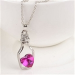 Silver bottle with pink heart necklace
