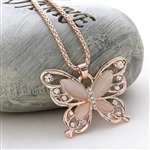 Gold and pink butterfly pendant necklace