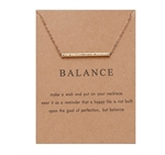 "Gold ""balance"" pendant necklace"