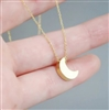 Gold moon pendant necklace