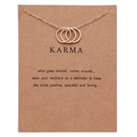 "Gold ""Karma"" pendant necklace"