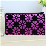 Pink and black wristlet/clutch purse with flowers