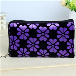 Purple and black wristlet/clutch purse with flowers