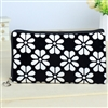 White and black wristlet/clutch purse with flowers
