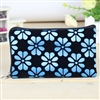 Blue and black wristlet/clutch purse with flowers