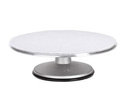"Cake Stand, 12"" Revolving With Non-Slip Pad, 613 by August Thomsen."