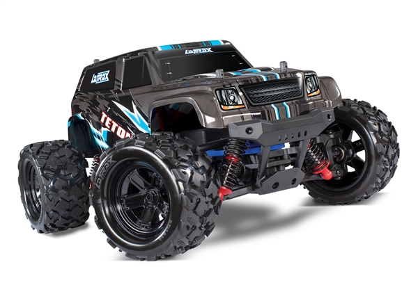 76054-5 - Teton: 1/18 Scale 4WD Electric Monster Truck. Ready-To-Race® and Powered by Traxxas® with ESC (fwd/rev) and brushed motor. Includes: 6-cell 7.2V NiMH battery with AC charger