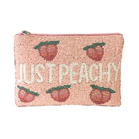 From St Xavier Just Peachy Beaded Clutch